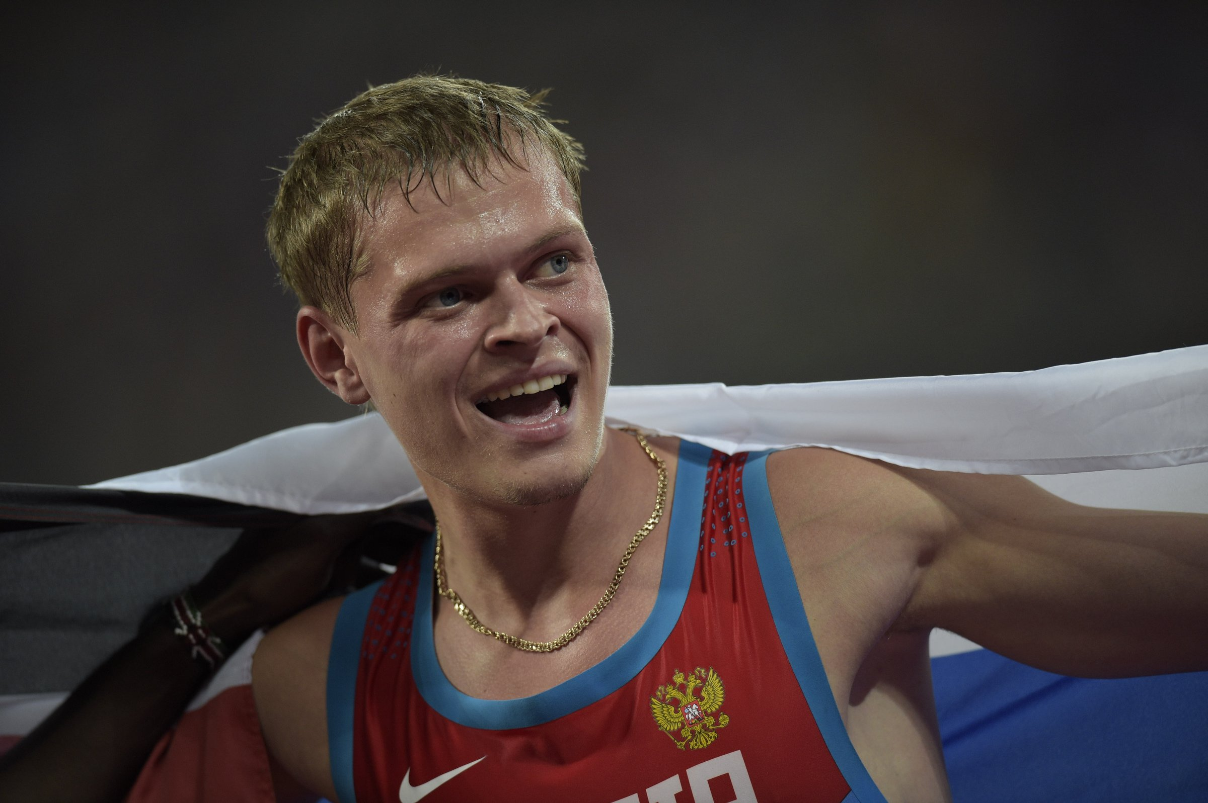 Denis Kudryavtsev (RUS) is all smiles after taking silver in the men's 400-meter hurdles.