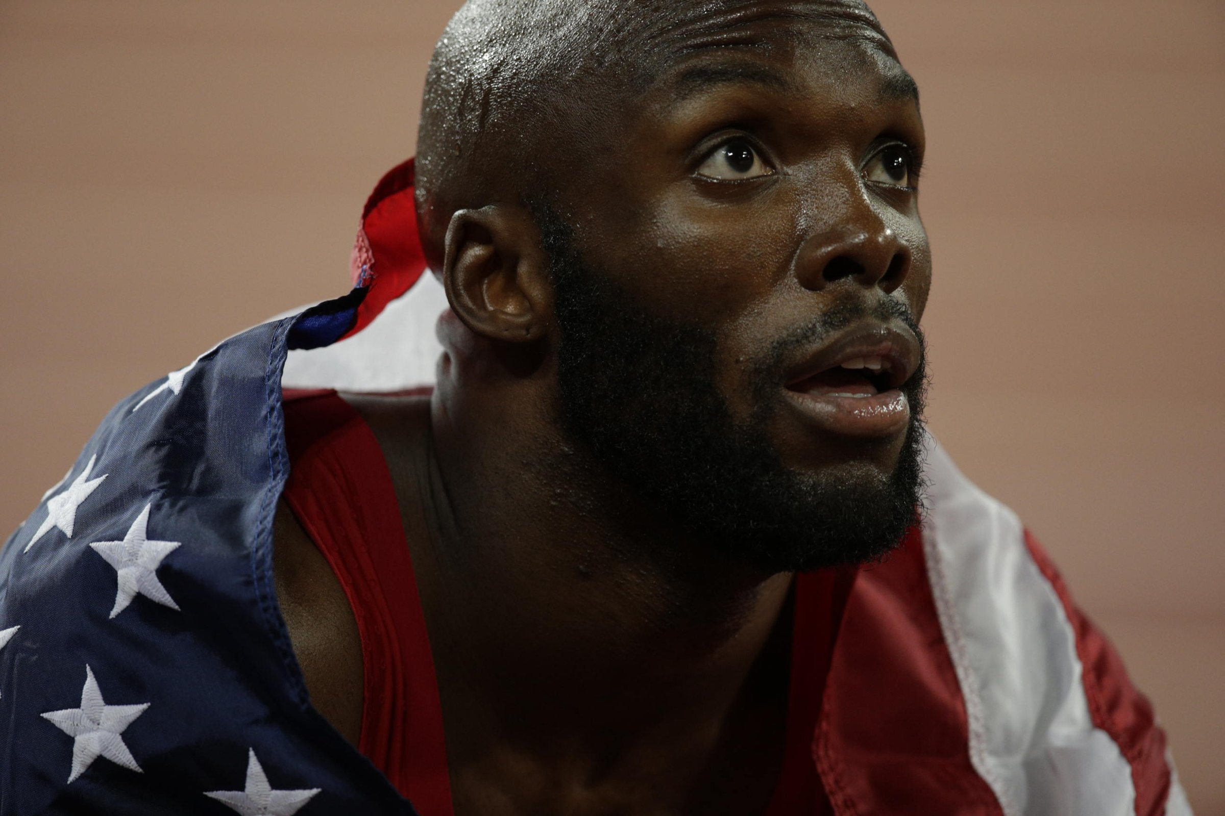 LaShawn Merritt (USA) looks up at the results board to see a new personal best of 43.65 for a silver medal in the men's 400.