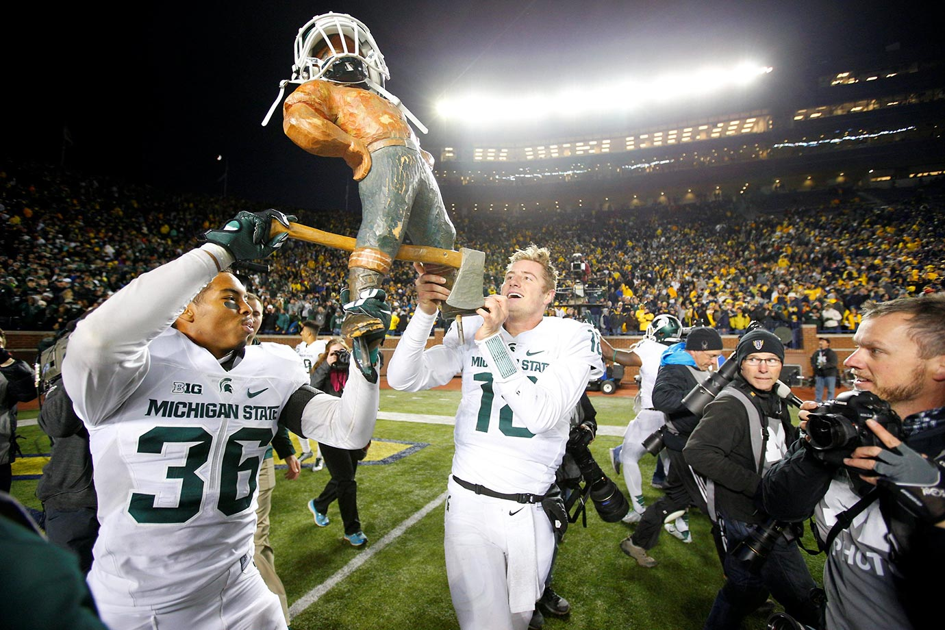 Arjen Colquhoun and Connor Cook of Michigan State hoist the the Paul Bunyan Trophy after beating Michigan.