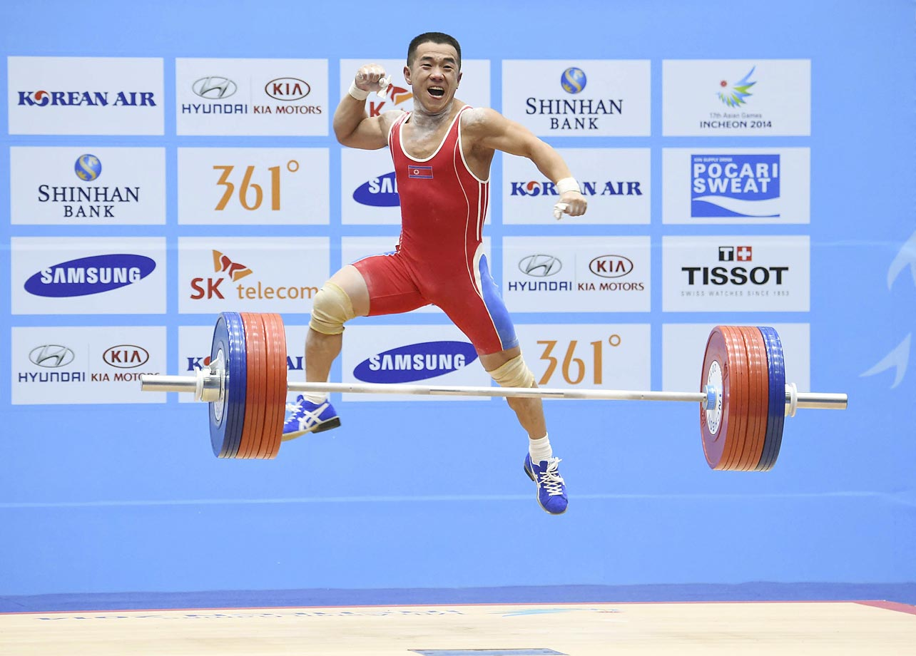 Yan Runzhe of China competes in the 56kg weightlifting division at the 2014 Asian Games.