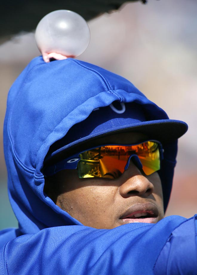 Kansas City Royals' Yordano Ventura wears a chewing gum bubble on his head courtesy of teammates during the fifth inning of a baseball game against the Detroit Tigers at Comerica Park, Sunday, Sept. 20, 2015, in Detroit. (AP Photo/Duane Burleson)