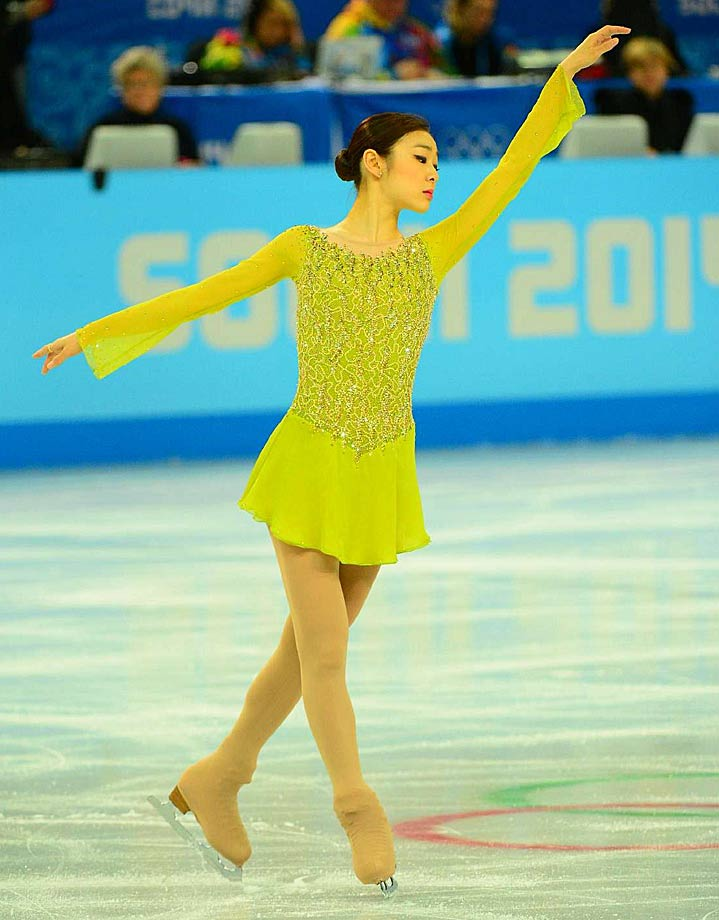 Yuna Kim of Korea, the reigning Olympic champion in women's figure skating, took the lead in Day 1 of the competition, the short program.
