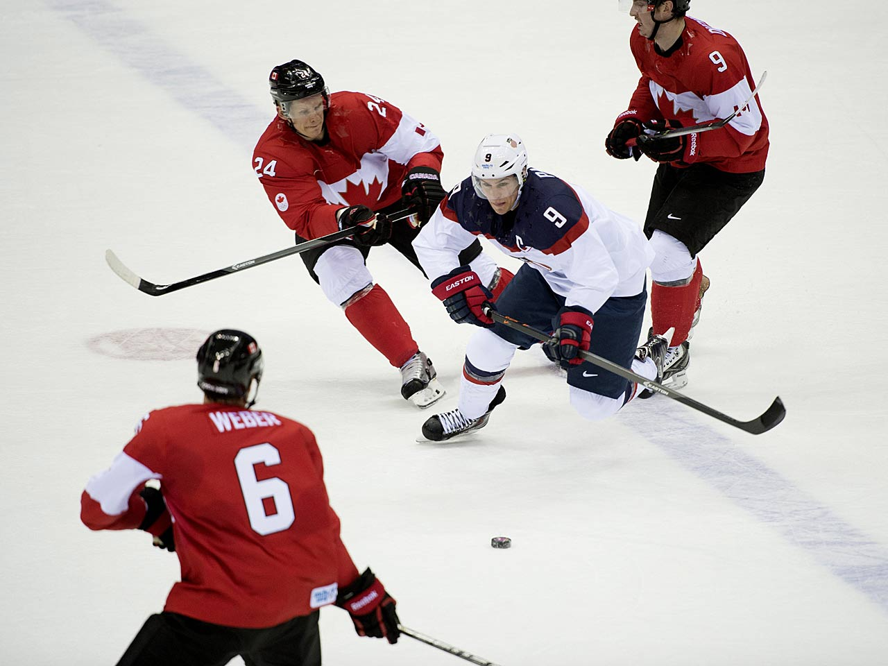 Zach Parise tries to maneuver through Canada's defense on a night when the U.S. was unable to establish any sort of presence in the attack zone.