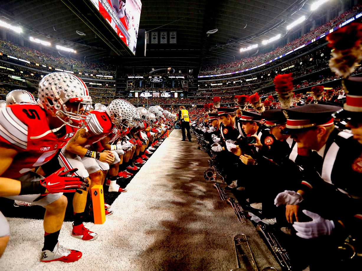 Ohio State Buckeyes players line up across the school's marching band before the start of the National Championship game.