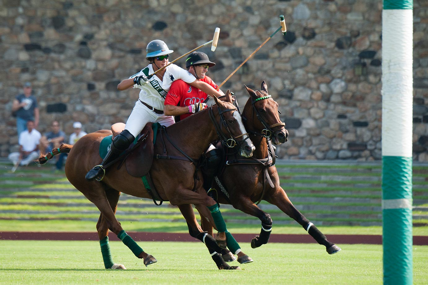 Nic Roldan, playing for the Audi Polo Team, and 14-year-old Santino Magrini battle it out.