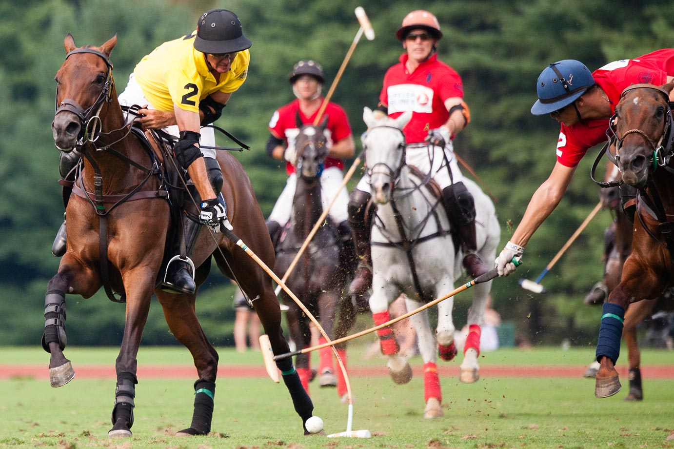 Turkish Airlines' Joaquin Panelo hooks McLaren's Nick Manifold's mallet during the 2015 East Coast Open Tournament.