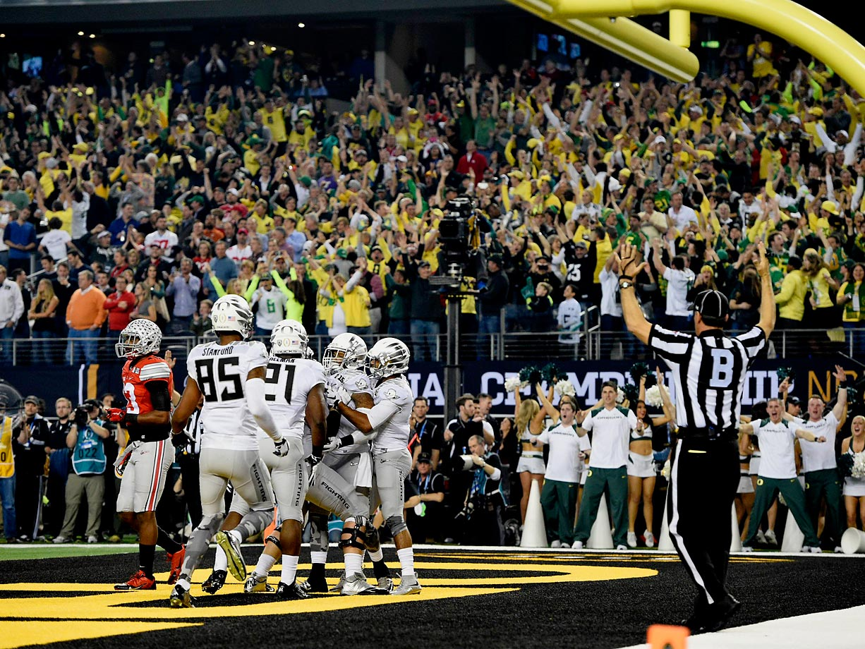 Oregon celebrates its first touchdown.