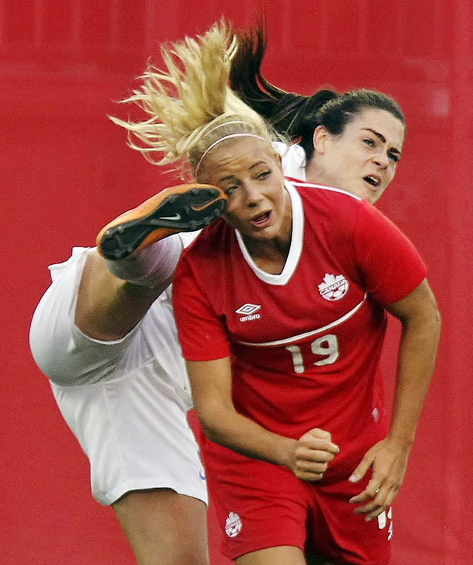 Adrianna Leon of Canada battles for the ball against Claire Rafferty of England during a friendly match in Hamilton, Ontario.