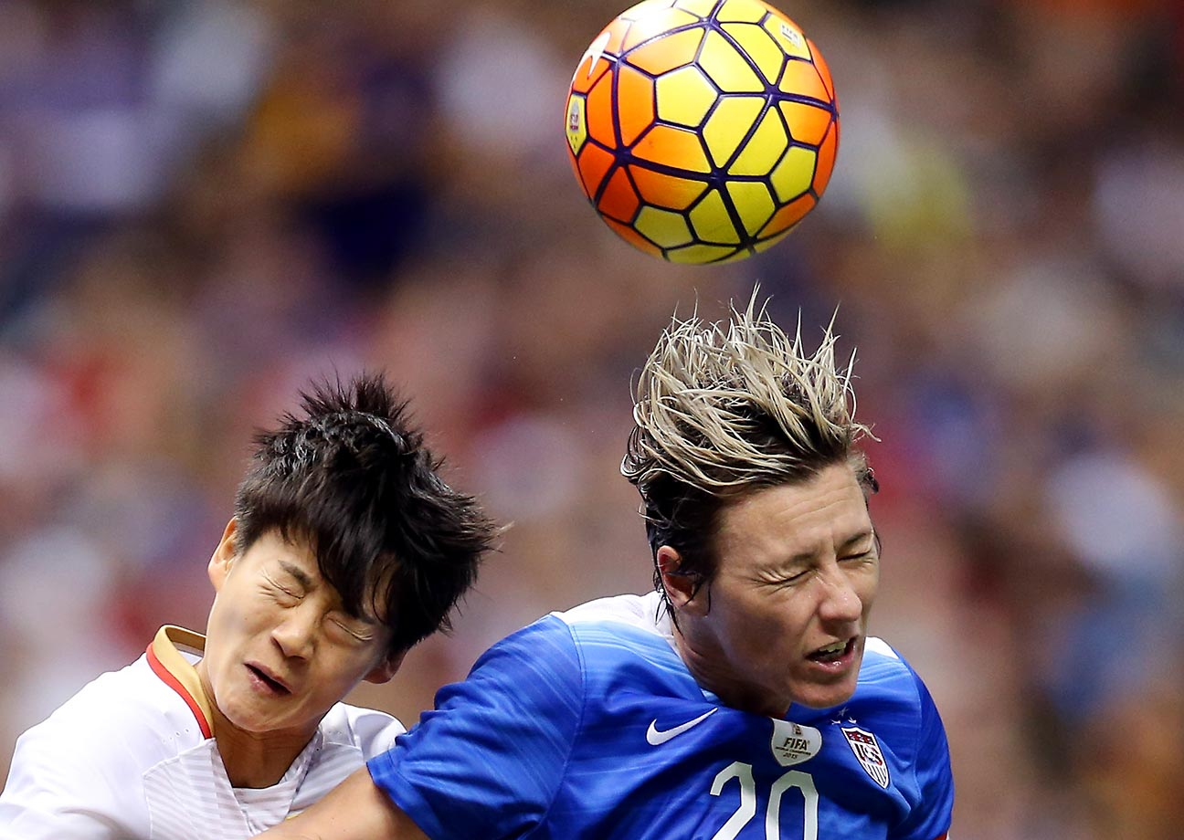 Abby Wambach of the U.S. fights for a ball against Li Dongna of China at the Mercedes-Benz Superdome in New Orleans.