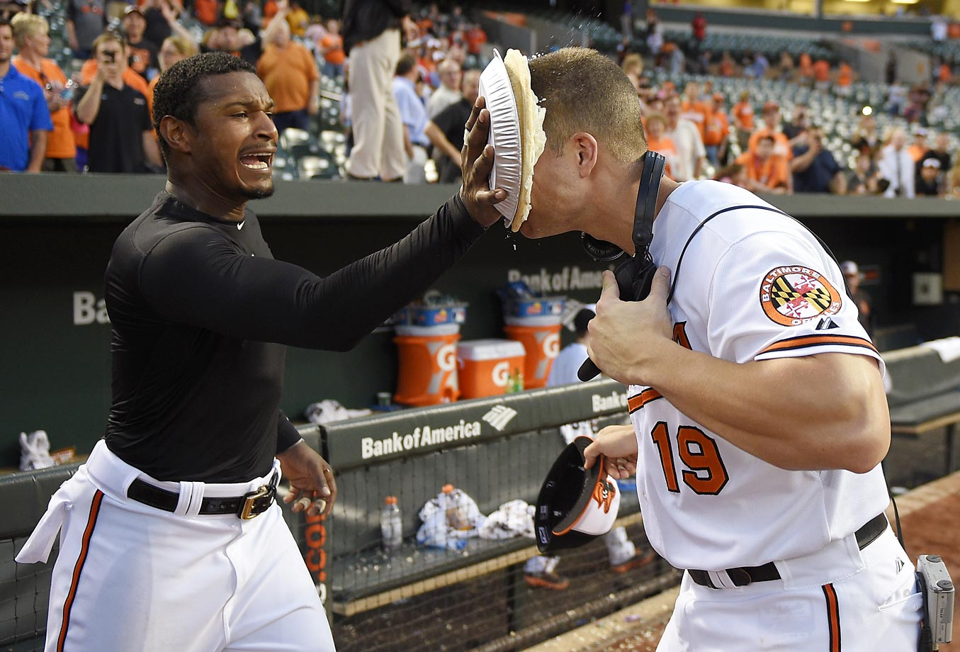 Adam Jones of the Baltimore Orioles throws a pie in the face of Chris Davis after the Orioles beat the Houston Astros 5-4.