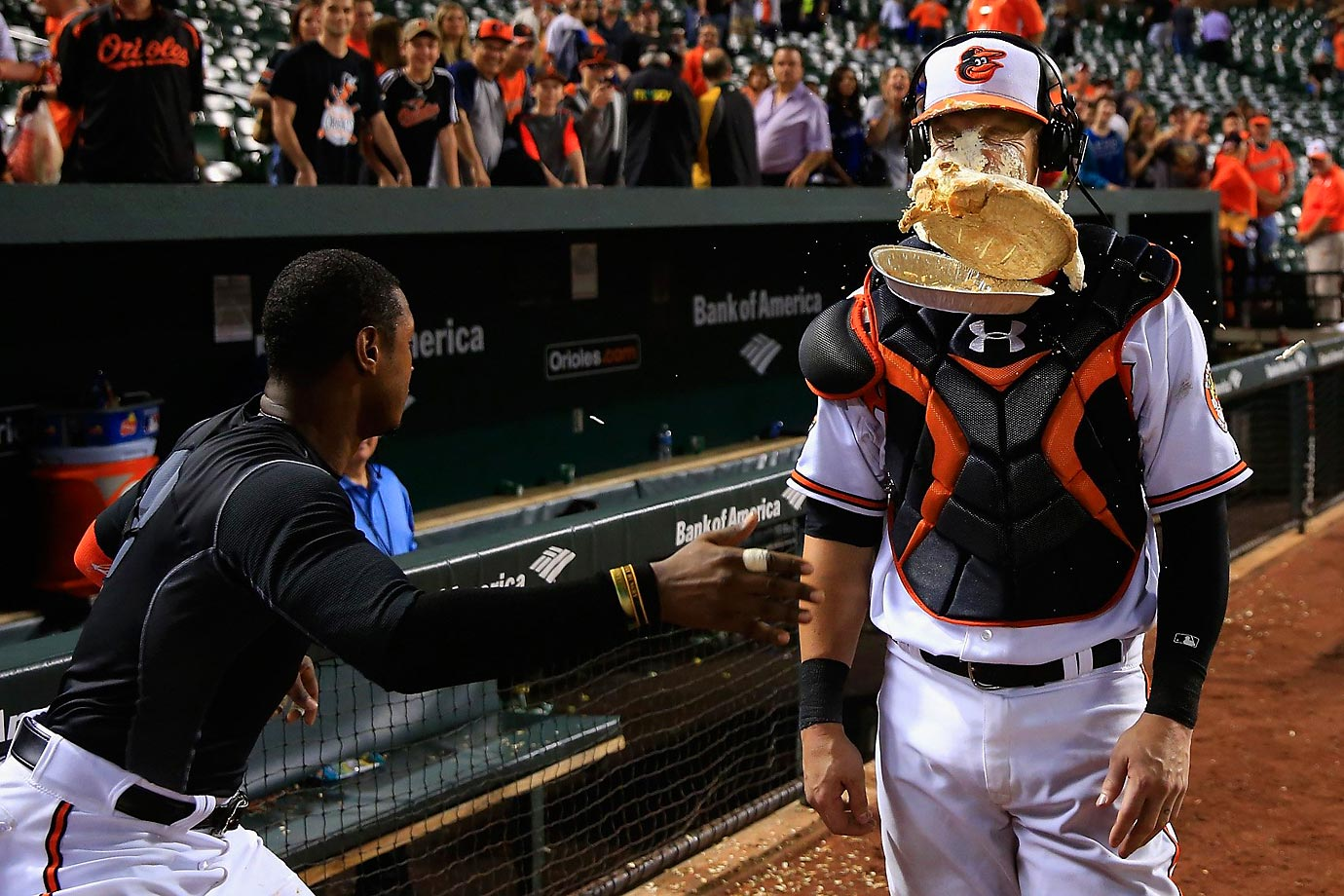 Adam Jones smacks Caleb Joseph of the Baltimore Orioles with a pie.