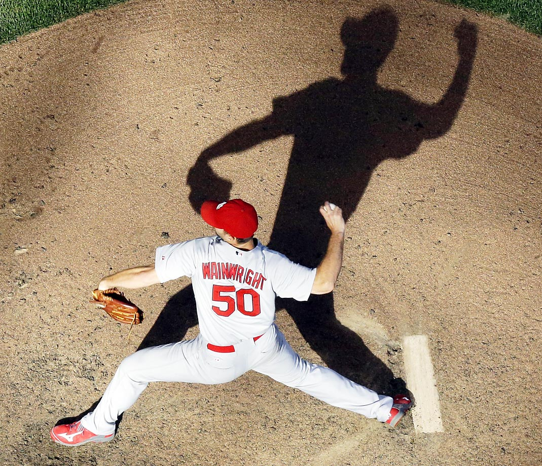 St. Louis Cardinals starting pitcher Adam Wainwright is followed by his shadow in the ninth inning against the Brewers.