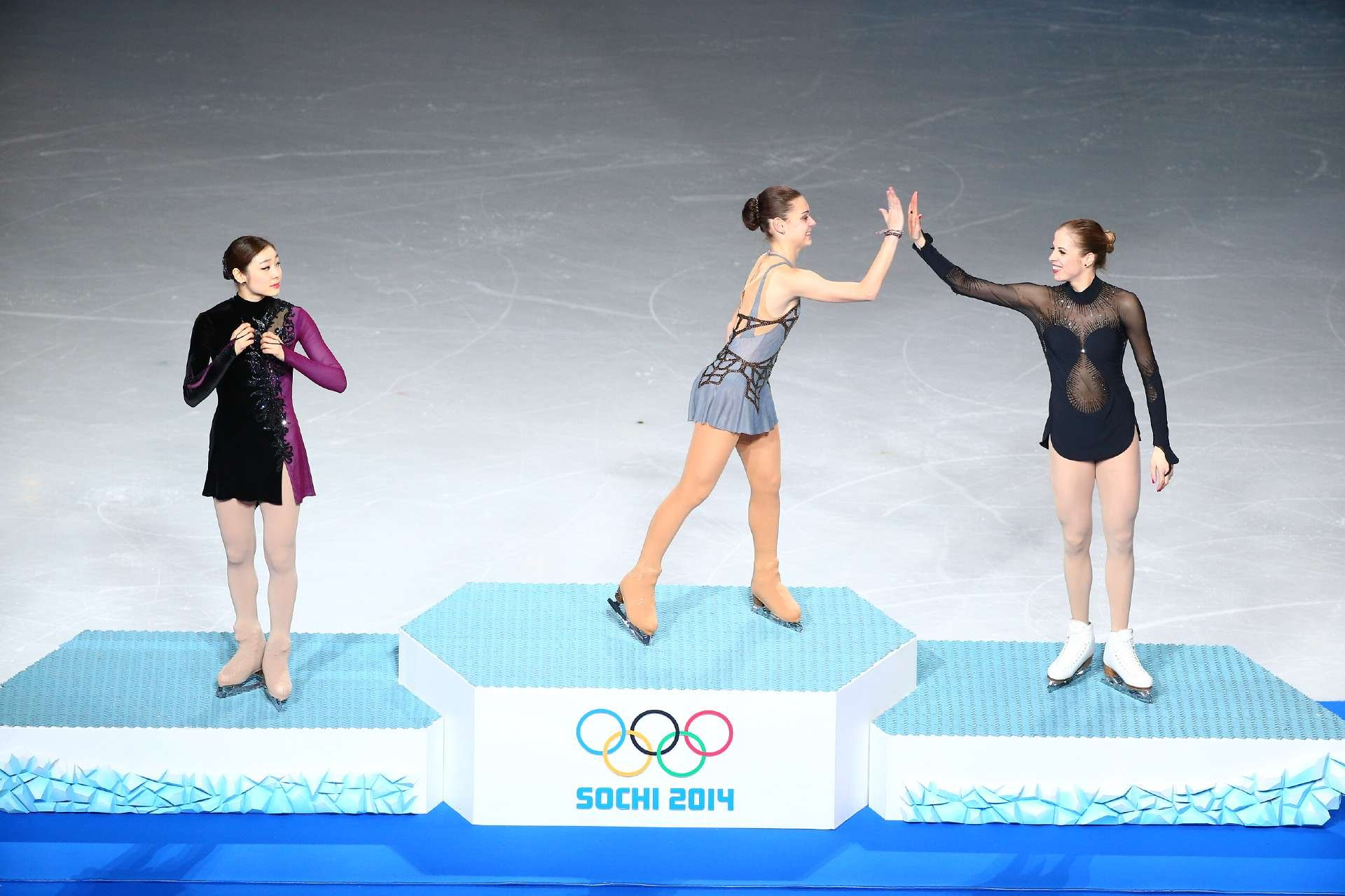Adelina Sotnikova gave Russia its first gold medal in women's Olympic figure skating, outscoring silver medalist Yuna Kim of South Korea and bronze medalist Carolina Kostner of Italy.