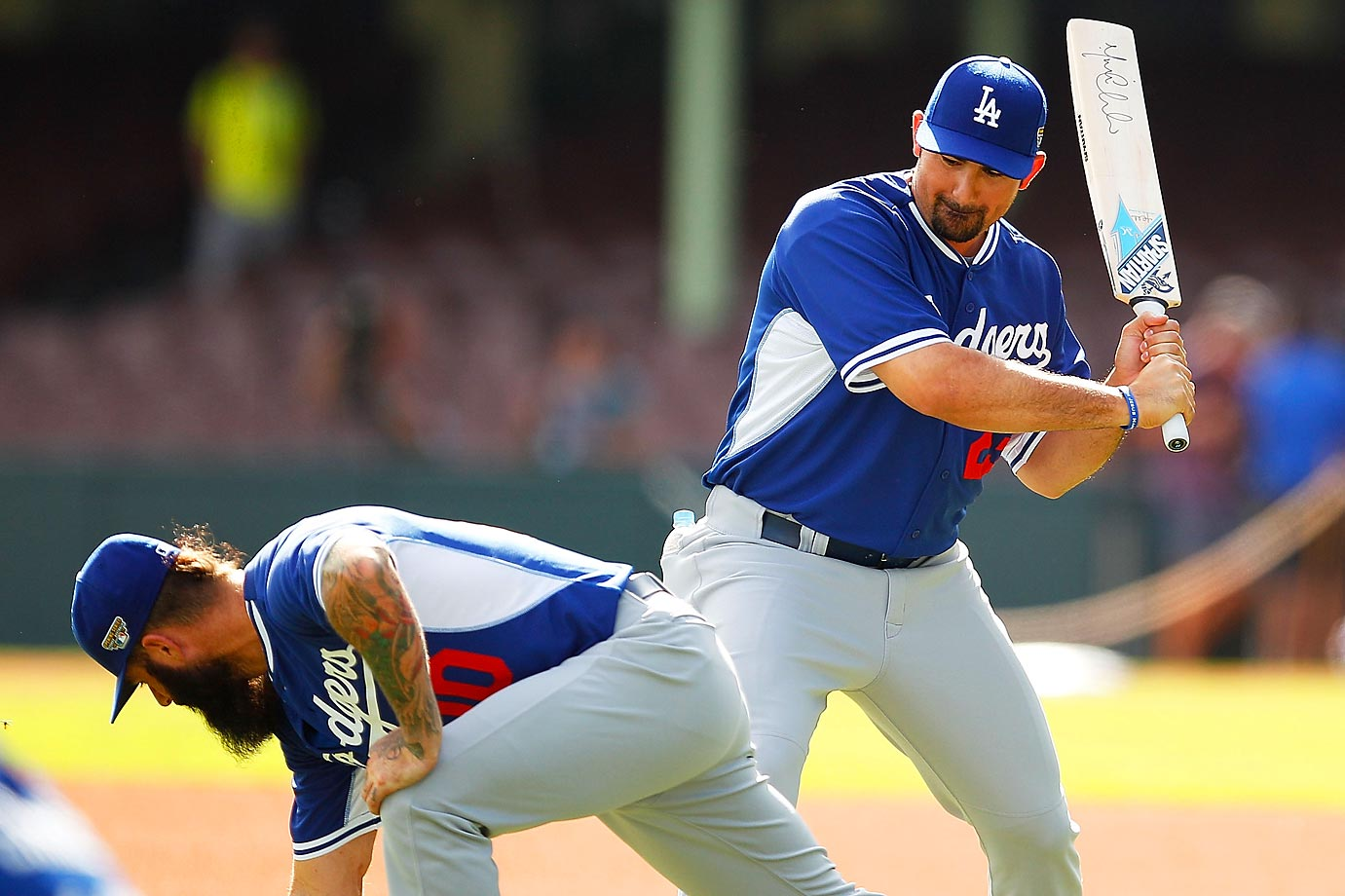 Adrian Gonzalez of the Dodgers gestures towards teammate Brian Wilson with a cricket bat during a training session in Australia.