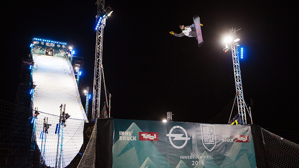 A snowboarder hits the jump at Air+Style Innsbruck.