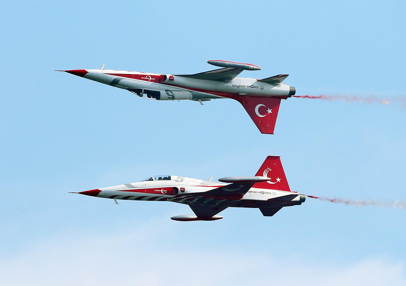The Turkish Stars aerobatic demonstration team performs with its supersonic jets during the Turkish International Service at Mehmetcik Abide in the Gallipoli Peninsula, Turkey.