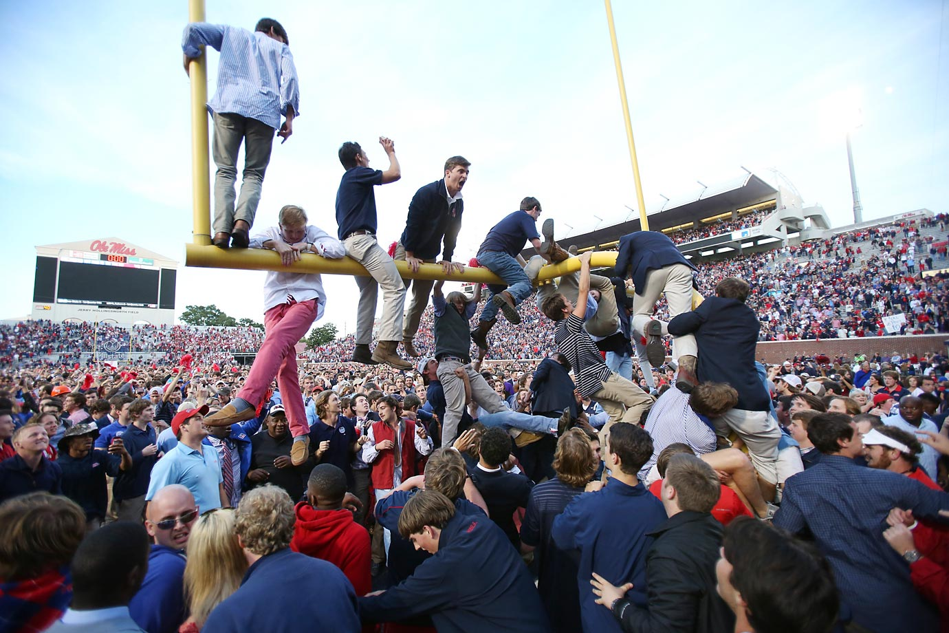 University of Mississippi students rush the field after Ole Miss upset rival Alabama 23-17.
