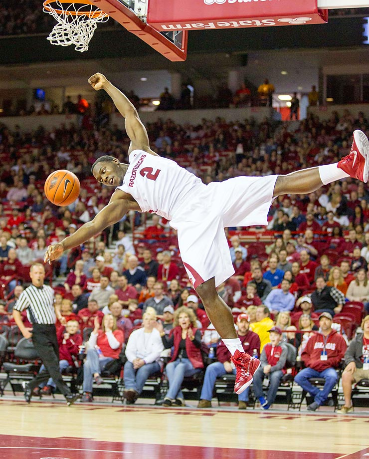 Arkansas forward Alandise Harris heads toward an awkward landing after dunking against Utah Valley.