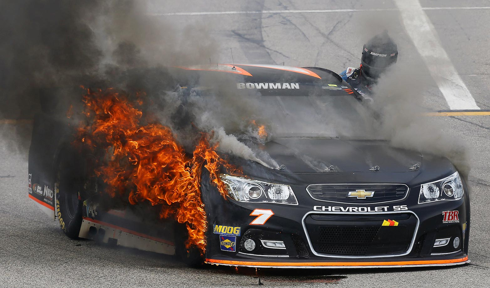 Alex Bowman climbs out of his burning car at the New Hampshire Motor Speedway.
