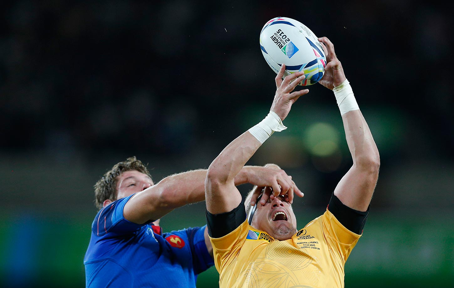 Alexandre Flanquart of France competes against Mihai Macovei of Romania during the Rugby World Cup Pool D match in London.