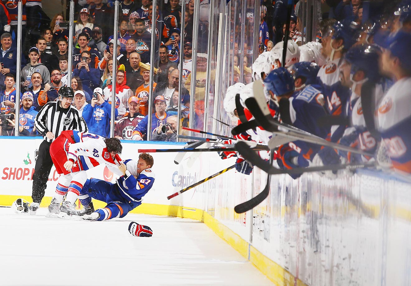 Anders Lee of the New York Islanders fights with Tom Wilson of the Washington Capitals. The Capitals won 5-2.