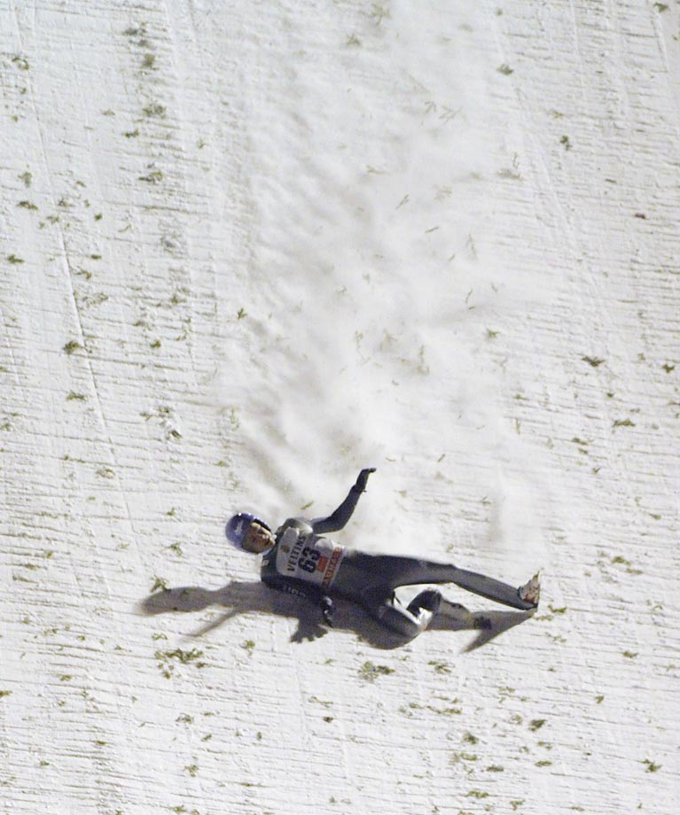 Germany's Andreas Wellinger slides down the slope after falling during the FIS Ski Jumping HS 142 World Cup in Finland.