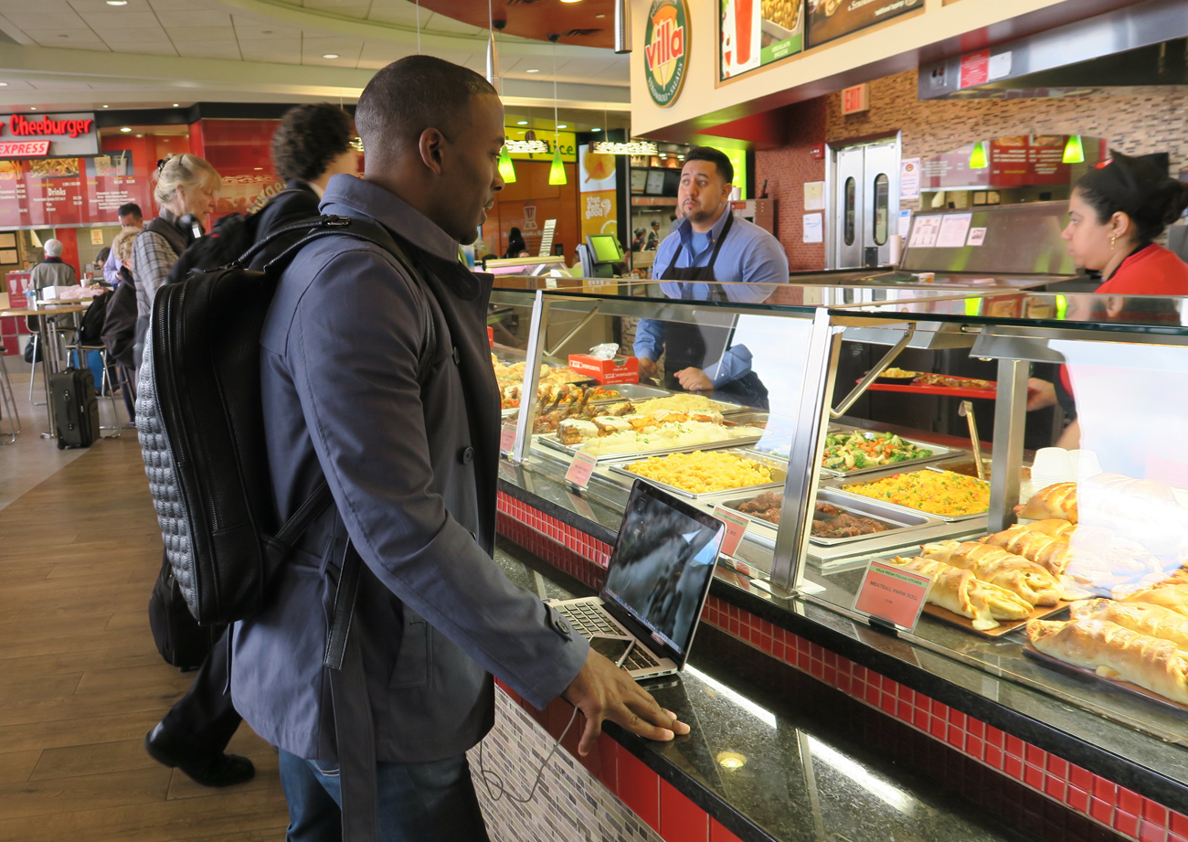 Browns receiver Andrew Hawkins in an airport food court before his sports management class at Columbia University.