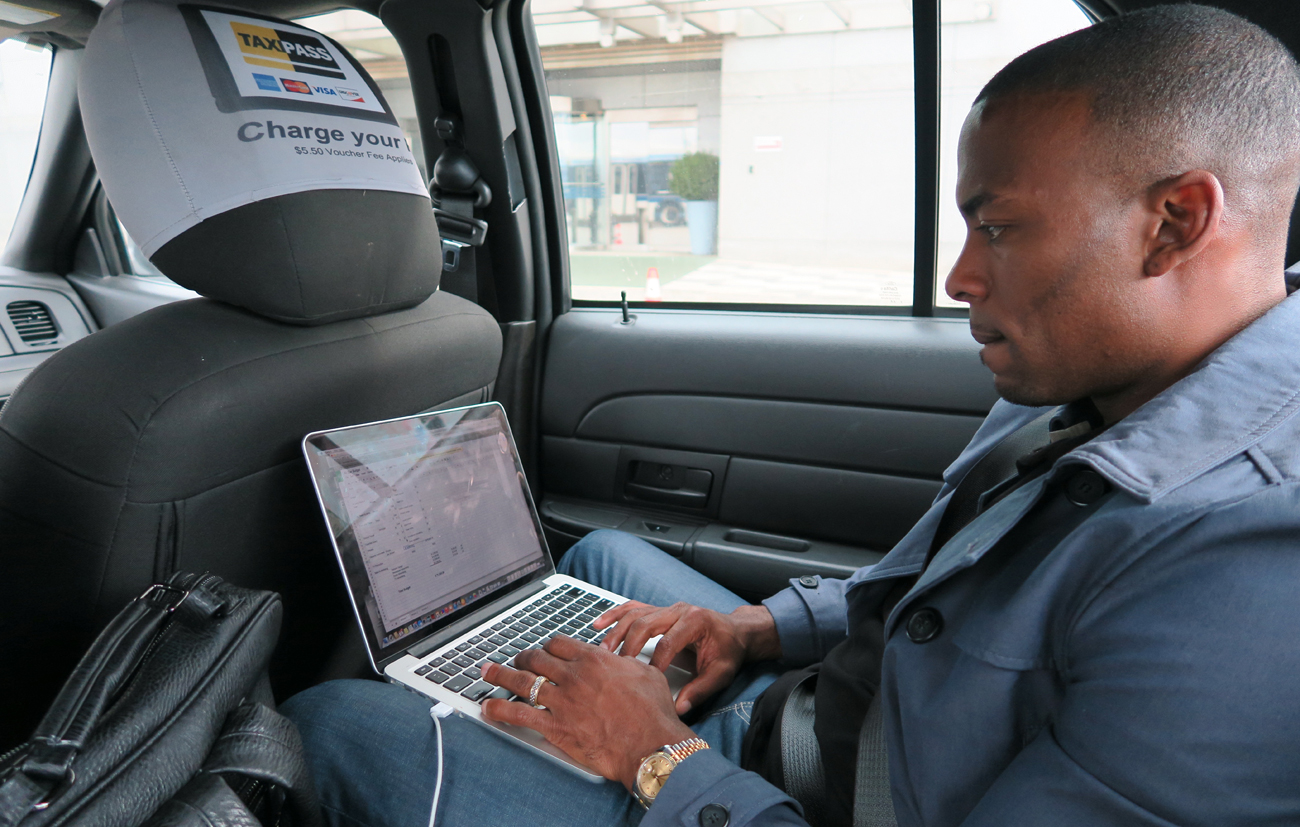 Browns receiver Andrew Hawkins does coursework in a cab before his sports management classes at Columbia University.