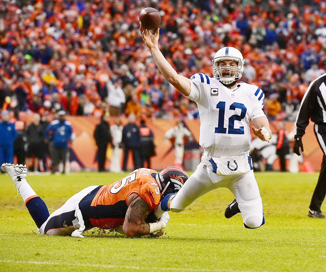 Andrew Luck throws the ball as he's tackled during the Indianapolis Colts' AFC Divisional Playoff game against the Denver Broncos.