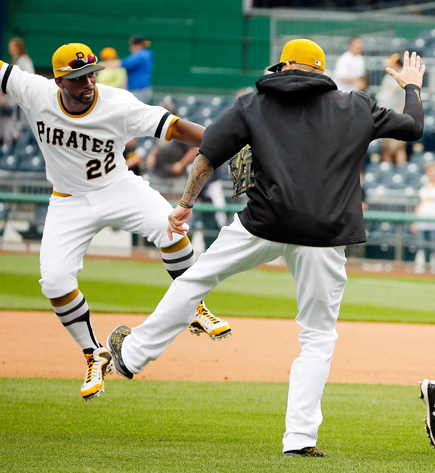 Andrew McCutchen (left) celebrates with A.J. Burnett after the Pittsburgh Pirates closed out a 5-2 win over Milwaukee.