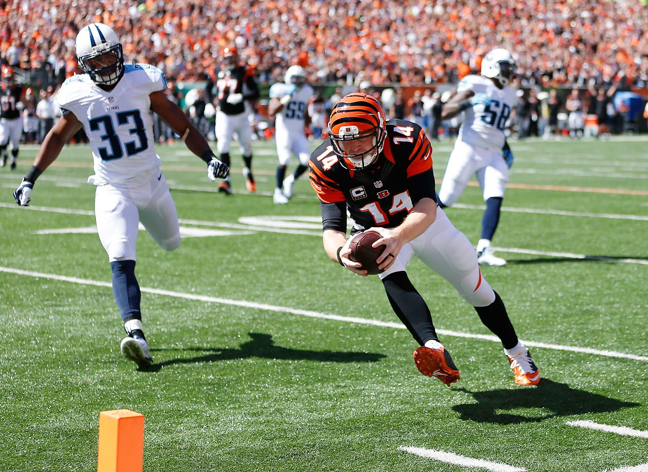 On the last play of the first quarter with the Bengals leading the Titans 3-0 in Sept. 2014, quarterback Andy Dalton caught a pass from wide receiver Mohamed Sanu, narrowly avoided a tackle or interception from cornerback Blidi Wreh-Wilson and sprinted into the endzone. He became the first quarterback in Bengals history to catch a touchdown pass.
