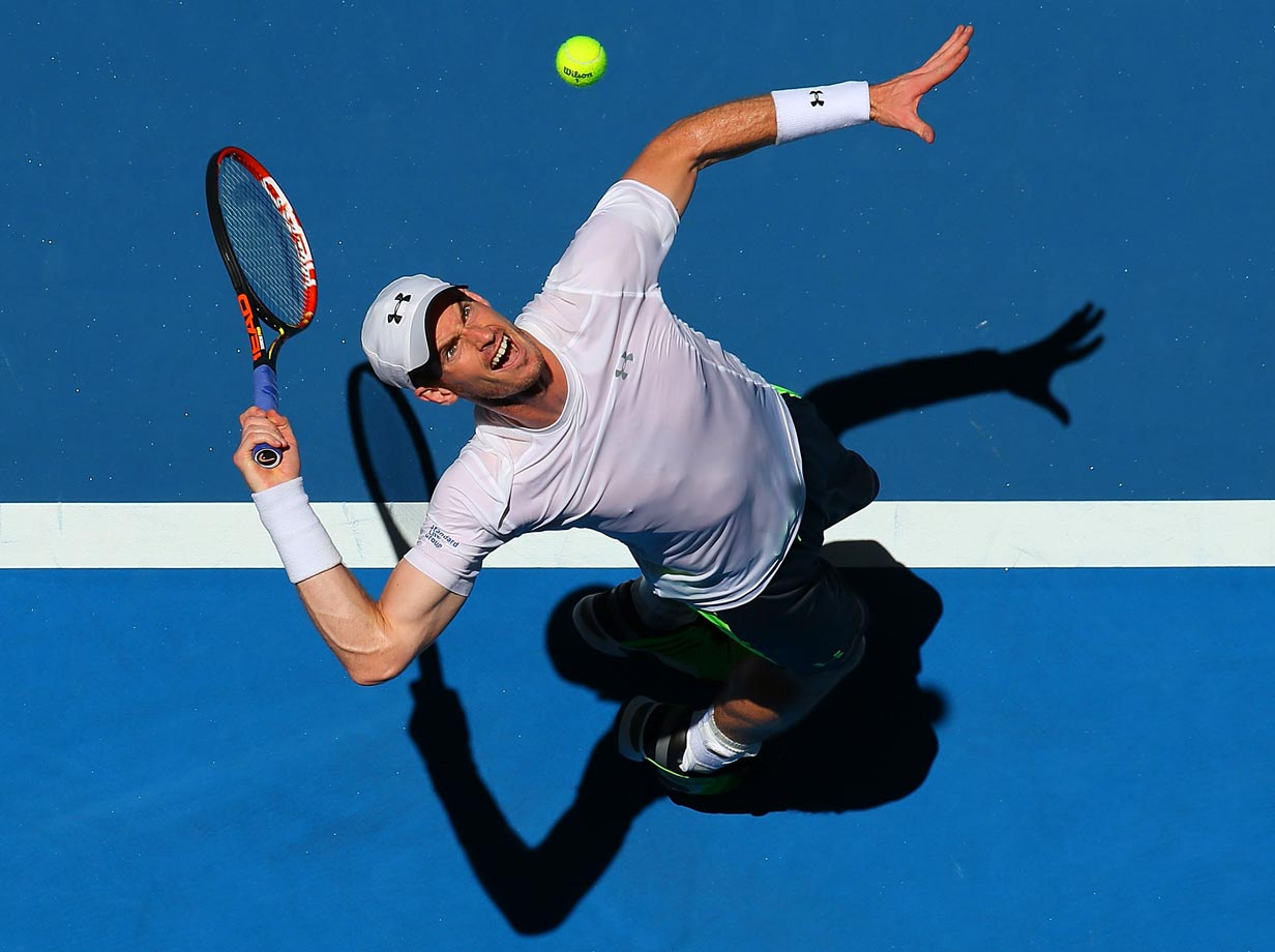 Andy Murray of Great Britain serves in his match against Jerzy Janowicz of Poland during day four of the 2015 Hopman Cup in Perth, Australia.