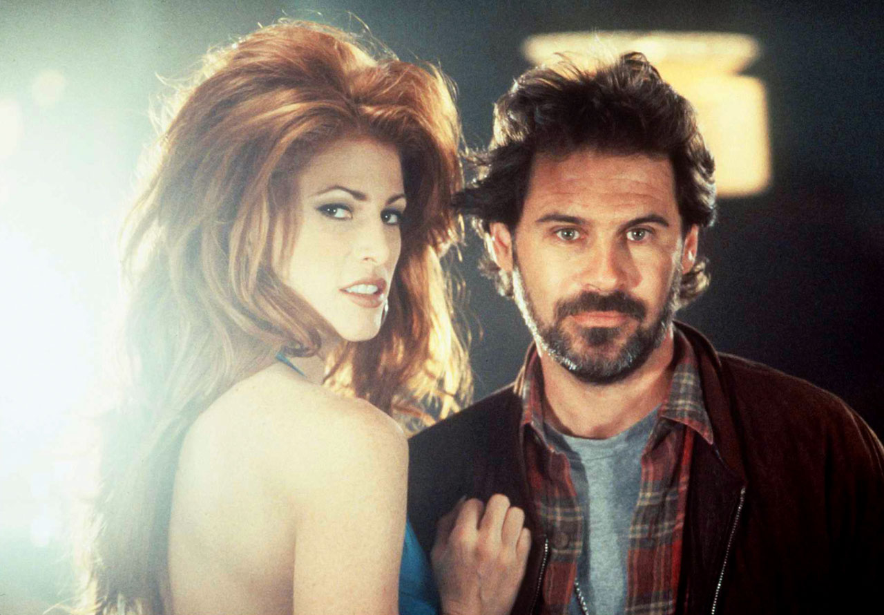 with Dennis Miller in Bordello of Blood (1996) -- Other notable films: The Last Action Hero (1993), Jade (1995), Another 9 1/2 Weeks (1997), Take Me Home Tonight (2011)