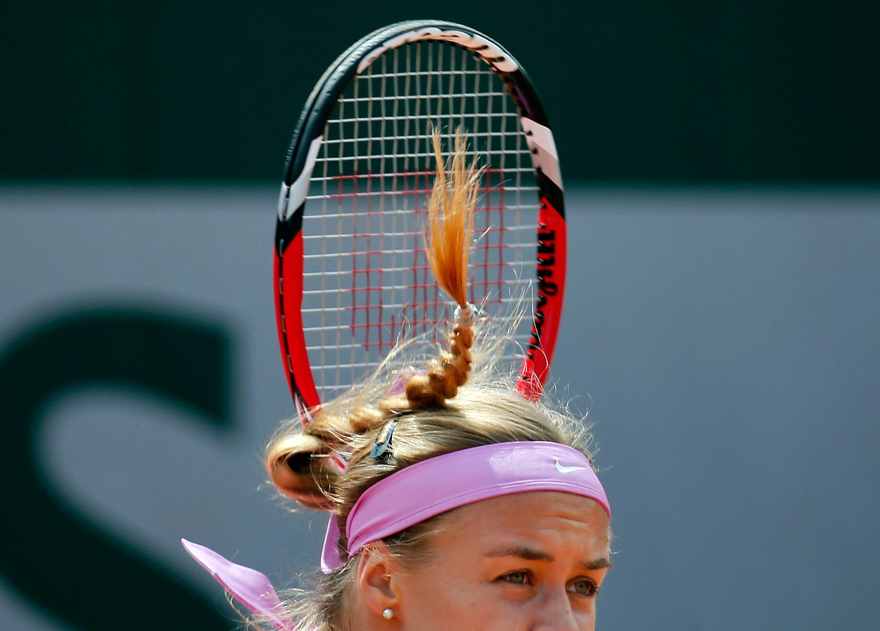 Anna Schmiedlova serves in a first-round match of the French Open.