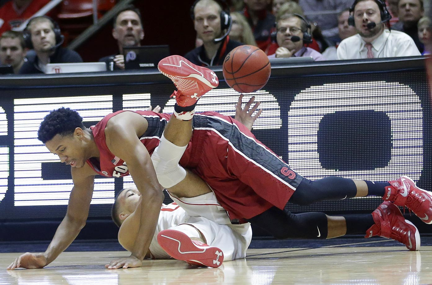 Stanford forward Anthony Brown, top, and Utah forward Brekkott Chapman battle for a loose ball.