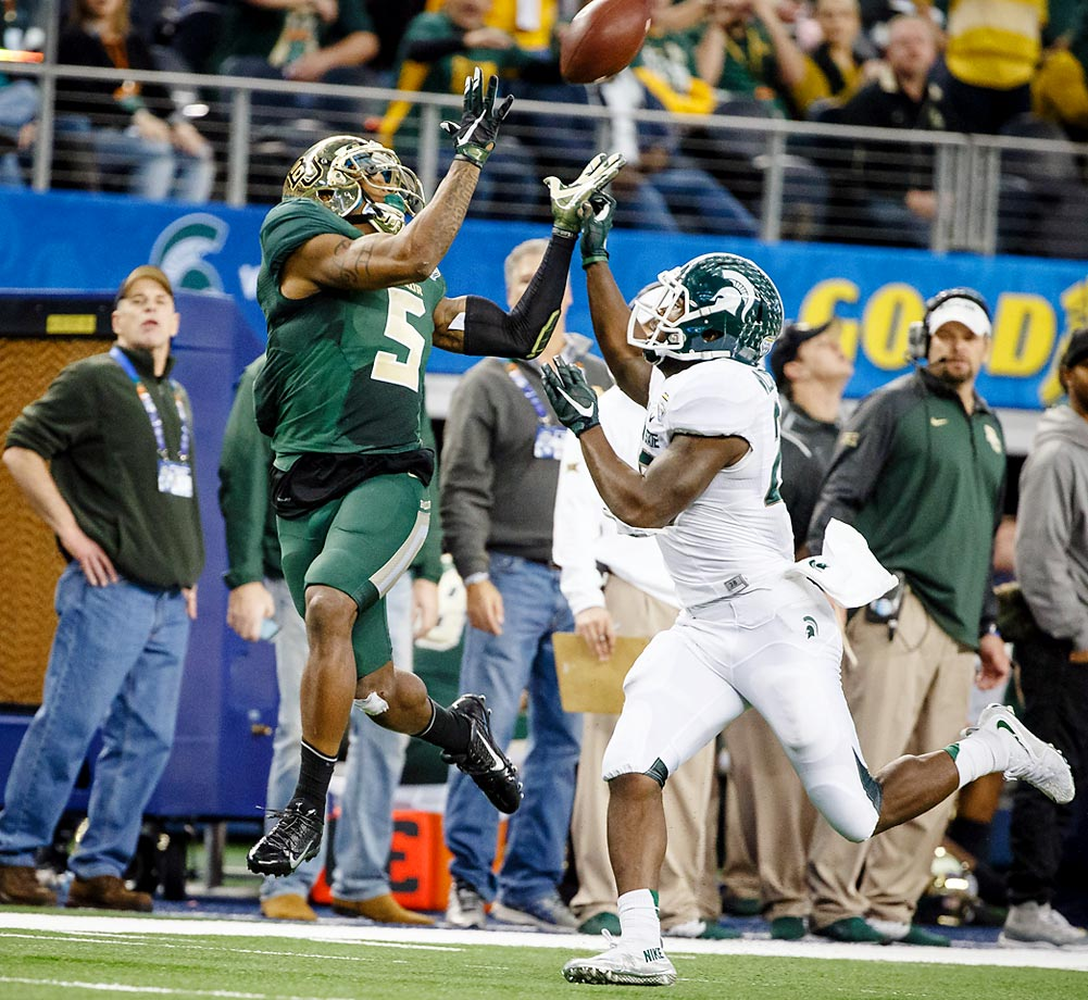 Baylor Bears wide receiver Antwan Goodley (5) makes a catch over Michigan State Spartans safety RJ Williamson (26) during the Goodyear Cotton Bowl Classic between the Michigan State Spartans and the Baylor Bears played at AT&T Stadium in Arlington, TX.