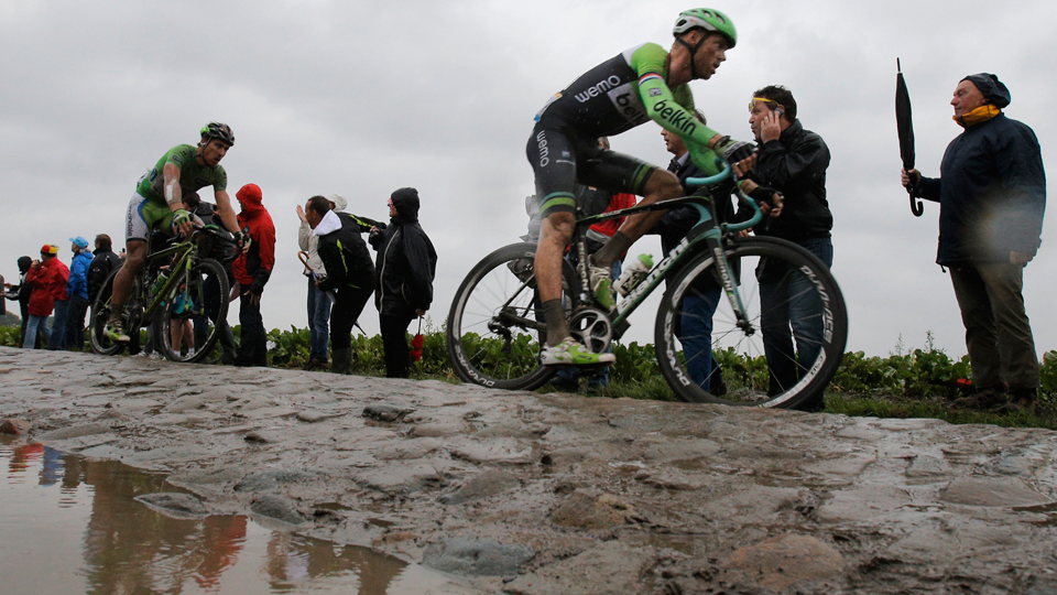 Stage winner Lars Boom of The Netherlands, right, and Peter Sagan of Slovakia, left, pass over a cobblestone sector during the fifth stage of the Tour de France cycling race over 155 kilometers (96.3 miles) with start in Ypres, Belgium, and finish in Arenberg, France, Wednesday, July 9, 2014.