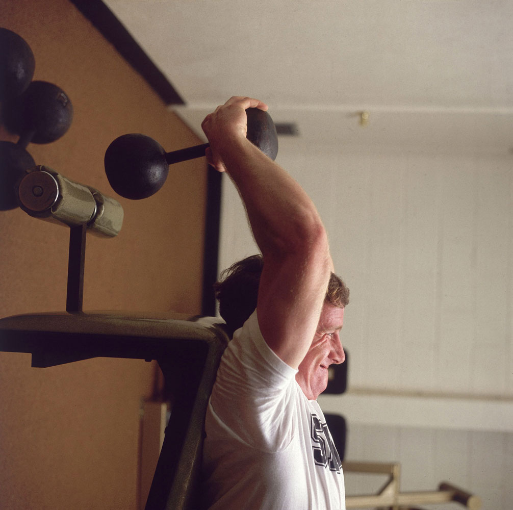 New Orleans Saints quarterback Archie Manning lifting barbells in weight room in New Orleans, LA, back in April 1981.