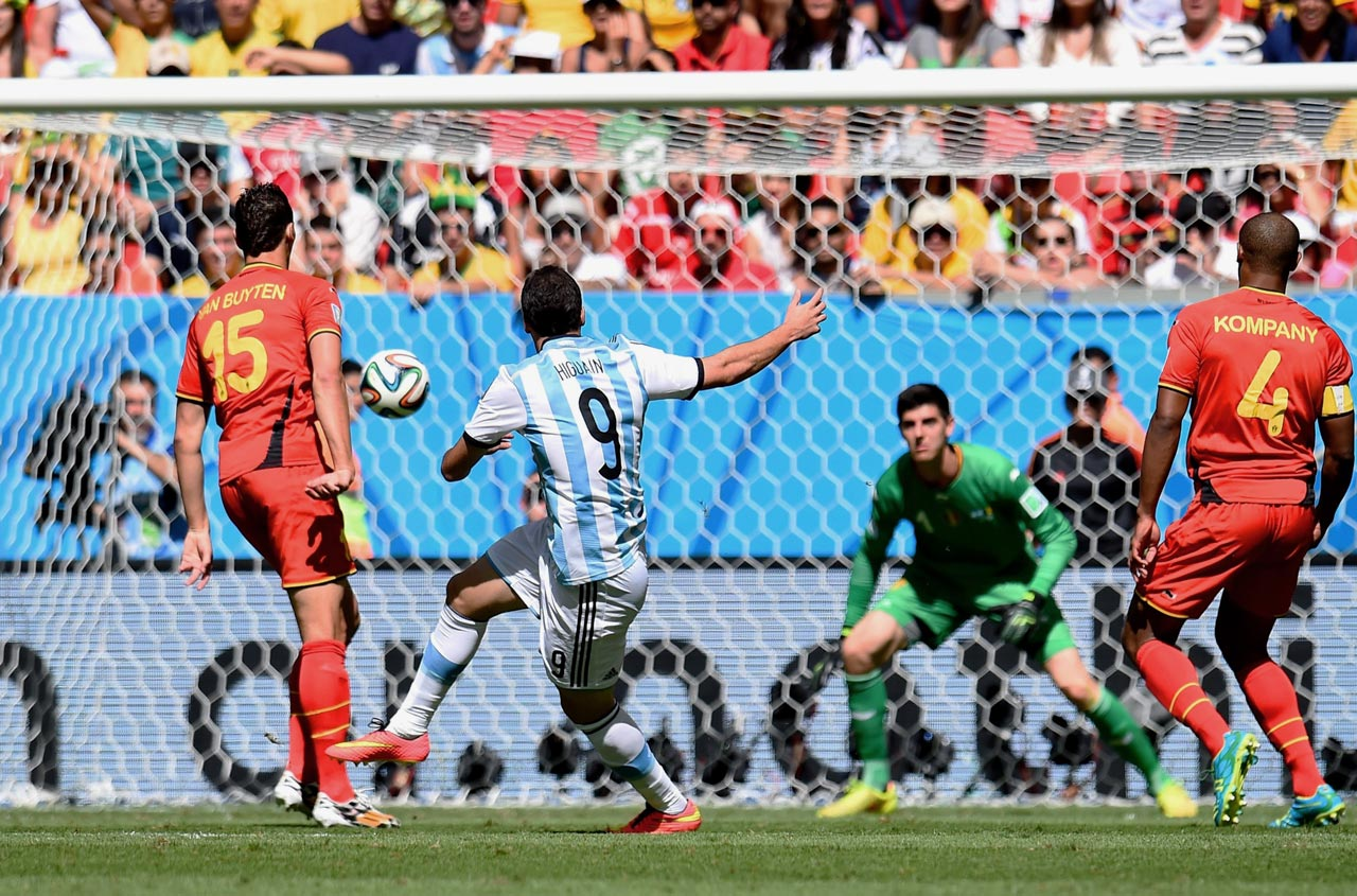 Gonzalo Higuain volleys home the lone goal in Argentina's 1-0 win over Belgium in the World Cup quarterfinals.
