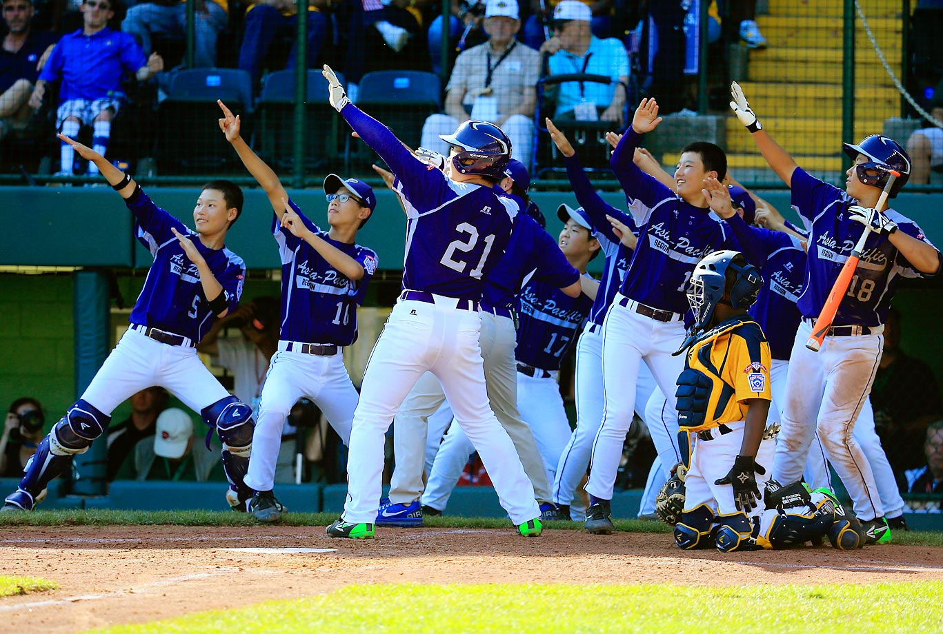 Seoul's Hae Chan Cho (21) celebrates with teammates after hitting a solo home run against Jackie Robinson West (Chicago) in the Little League World Series finale.