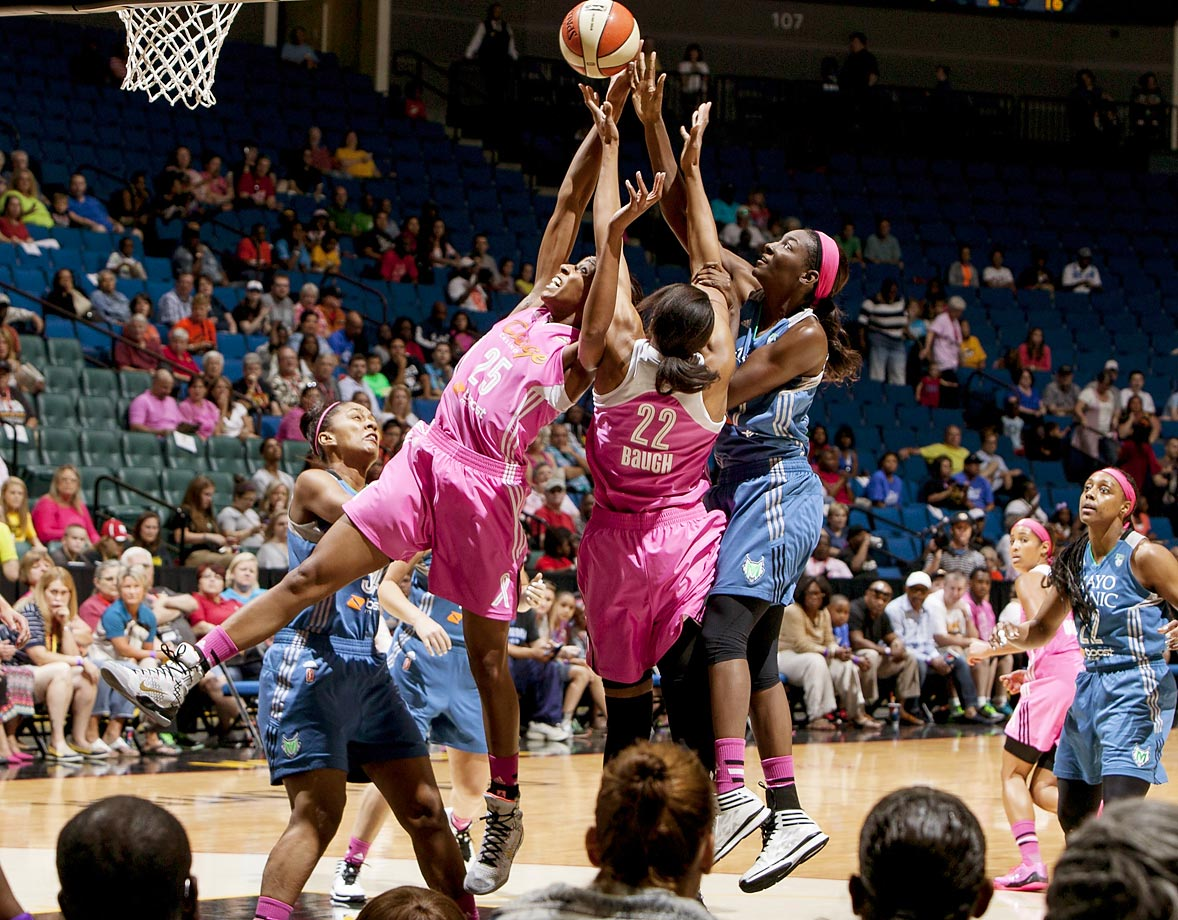 Asia Taylor of the Minnesota Lynx battles for a rebound with Vicki Baugh and Glory Johnson of the Tulsa Shock during the WNBA game on August 2, 2014 at the BOK Center in Tulsa, Oklahoma.