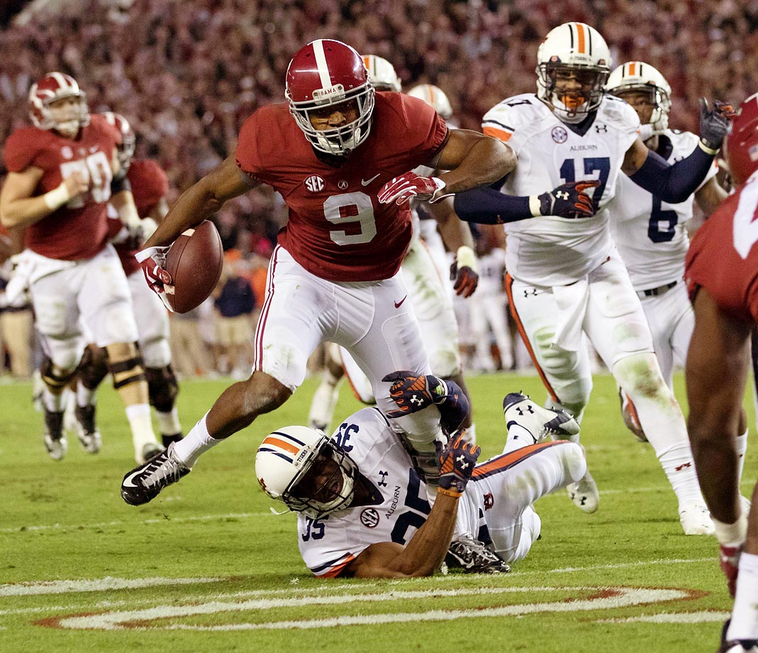 Auburn's Joe Turner attempts to bring down Alabama running back Amari Cooper. Cooper finished with 224 yards in Alabama's 55-44 win.