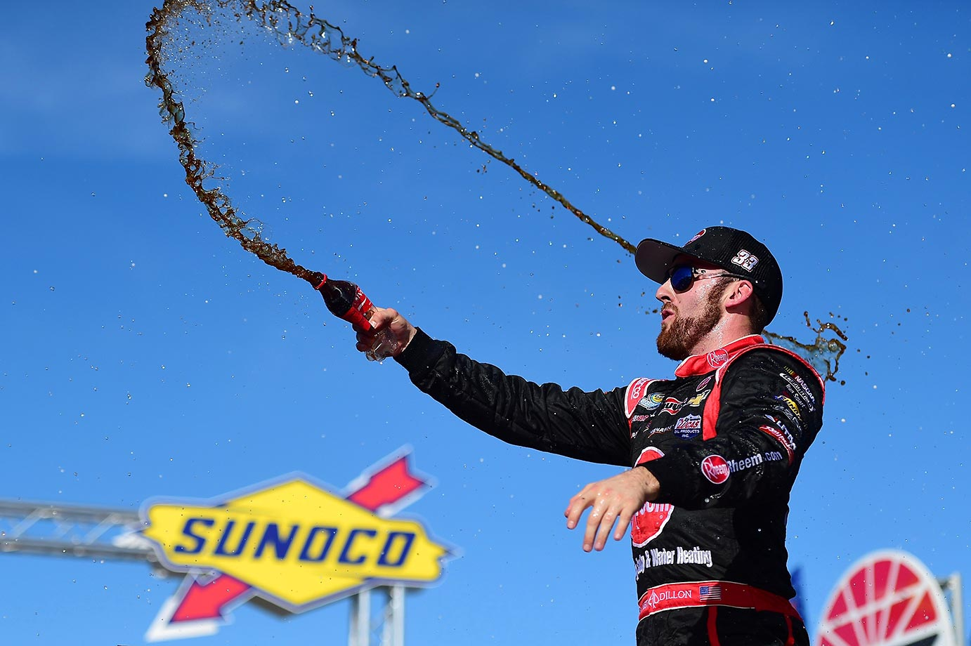 Austin Dillon celebrates after winning the NASCAR Camping World Truck Series UNOH 175 at New Hampshire Motor Speedway.