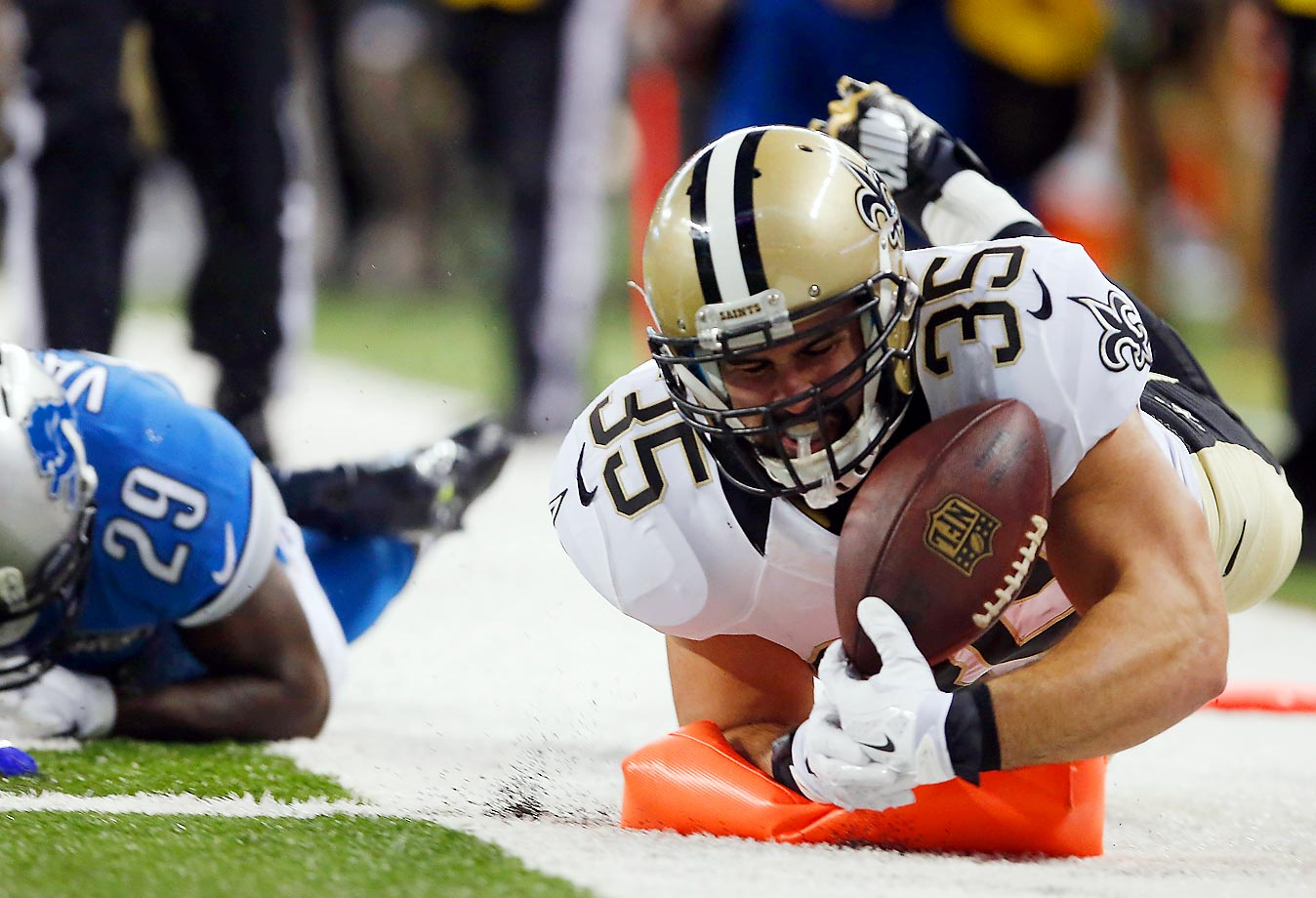 Austin Johnson of the New Orleans Saints dives for a second-quarter touchdown against the Detroit Lions. The Lions came from behind to win 24-23.