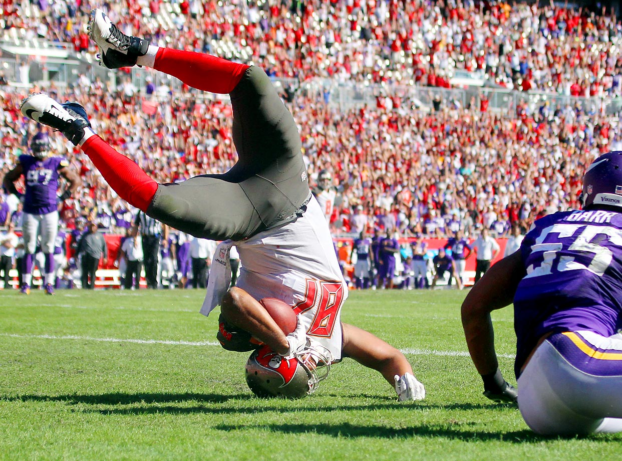 Austin Seferian-Jenkins of the Bucs scores a touchdown on this flip in a game against the Vikings.