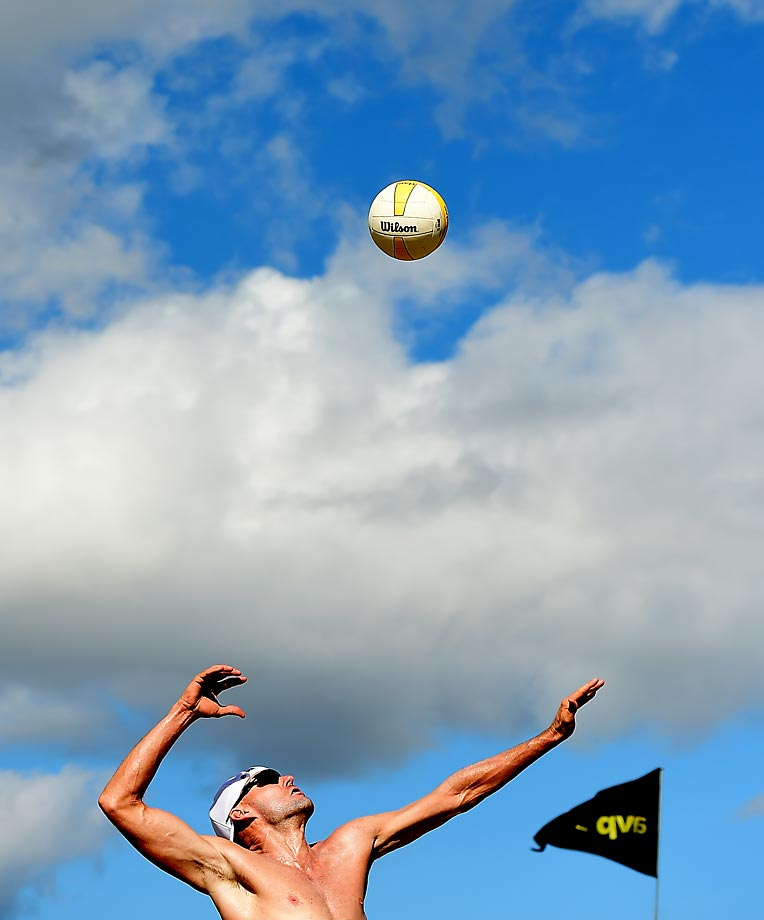 Jake Gibb serves through the Seattle sky. Jake finished with 14 aces for the tournament.
