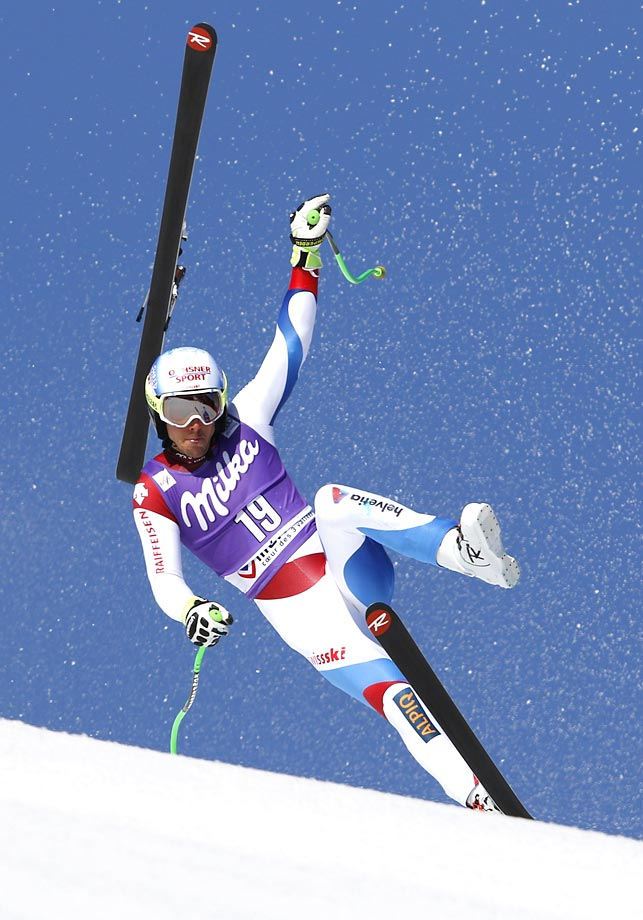 Carlo Janka of Switzerland loses his ski and crashes during the super-G race at the World Cup finals in Meribel, France.