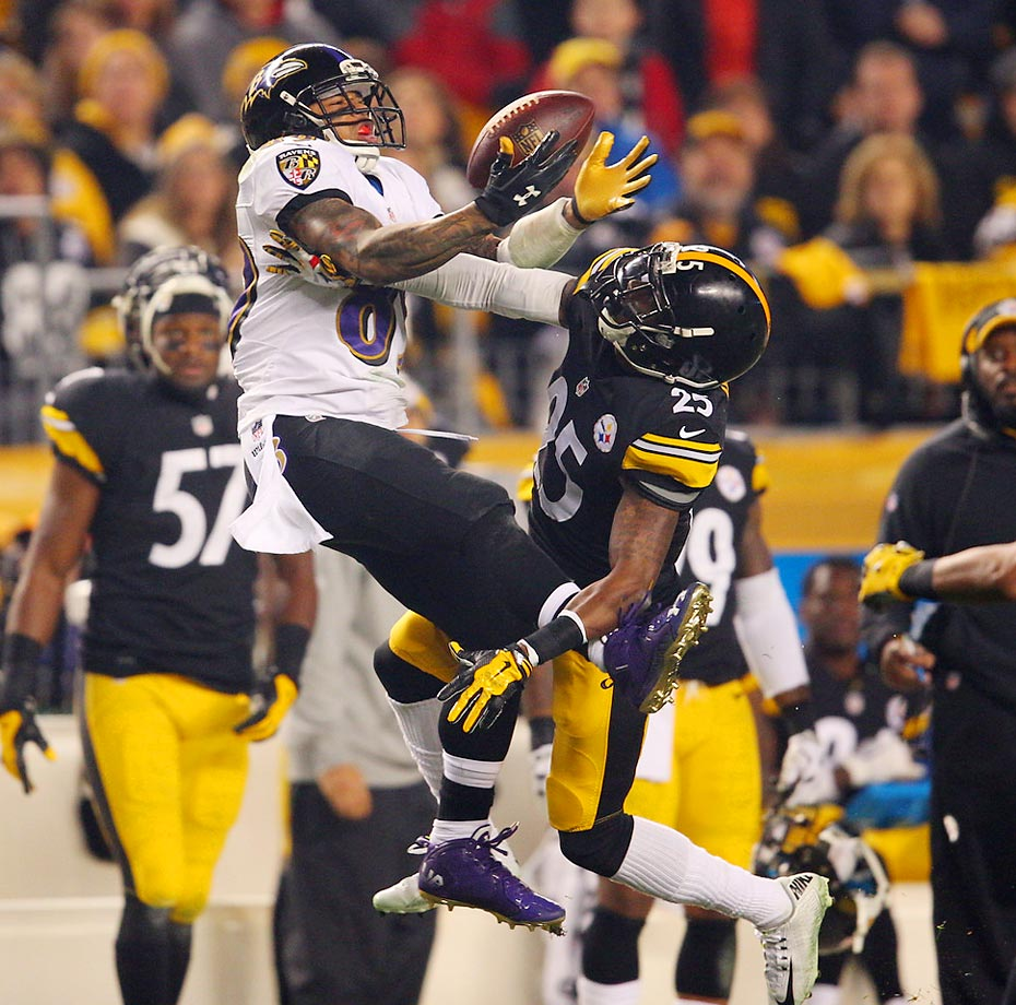 Pittsburgh Steelers cornerback Brice McClain tries to dislodge the ball from the arms of Baltimore Ravens wide receiver Steve Smith during an AFC Wild Card Playoff game.