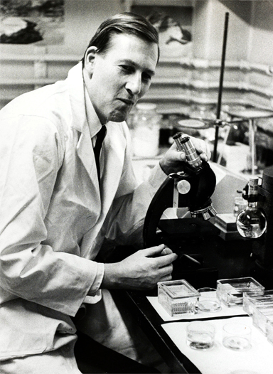 Dr. Roger Bannister working in the lab at Harvard University in 1962.