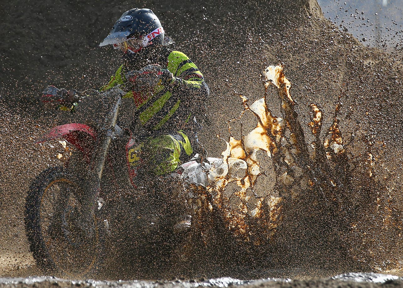A competitor ploughs through heavy conditions in the adult solo race of the RHL Weston Beach Race in Somerset, United Kingdom.
